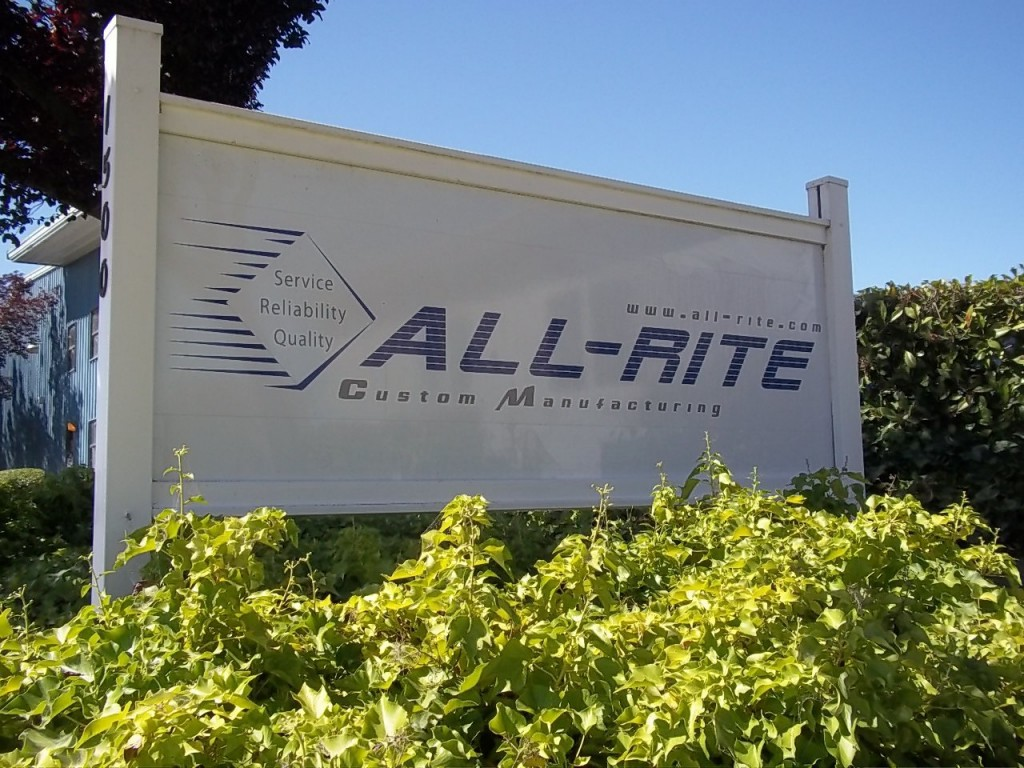 Our All-rite Sign in front of our Hollister, Ca manufacturing plant for custom limousine parts and accessories.